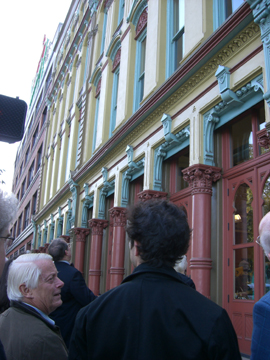 "William J. Hawkins Leading a tour of Portland's cast-iron architecture.  For those of you who guessed ""Bickel Block"" as the solution for the mystery building photo, congratulations, you're right.  Here it is in its restored state.  Photo by D. Pinyerd."