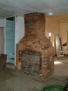 Interior of Gorman House with  original fireplace/chimney of hand-made bricks and mud mortar. Photo by Liz Carter