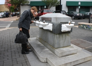Members Susan Boyle and Henry Matthews sample Lithia Springs water at the fountain in downtown Ashland. Photo: D. Painter