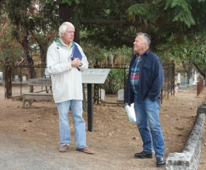 Tour leaders Dirk Siedlecki and Scott Clay chat between showers at the Jacksonville Cemetery. Photo: D. Painter