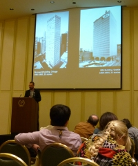 "Tyler Sprague in action, presenting The Rise of the Exterior Bearing Wall, or ""Tube"" Skyscraper: An Alternative Perspective from Seattle. Photo by B. Niederer."